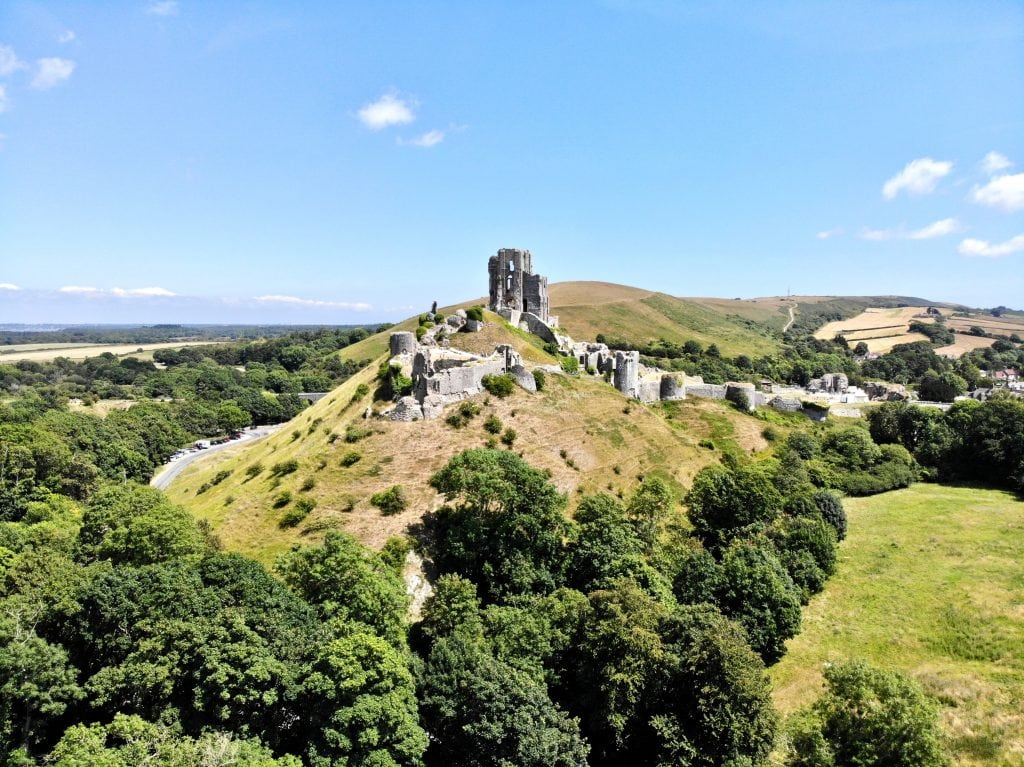 Arial shot of Corfe Castle on the Isle of Purbeck