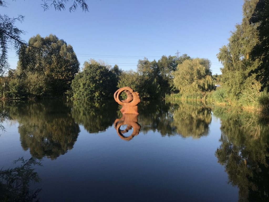 sculpture in a body of water in a park near Dorchester Dorset