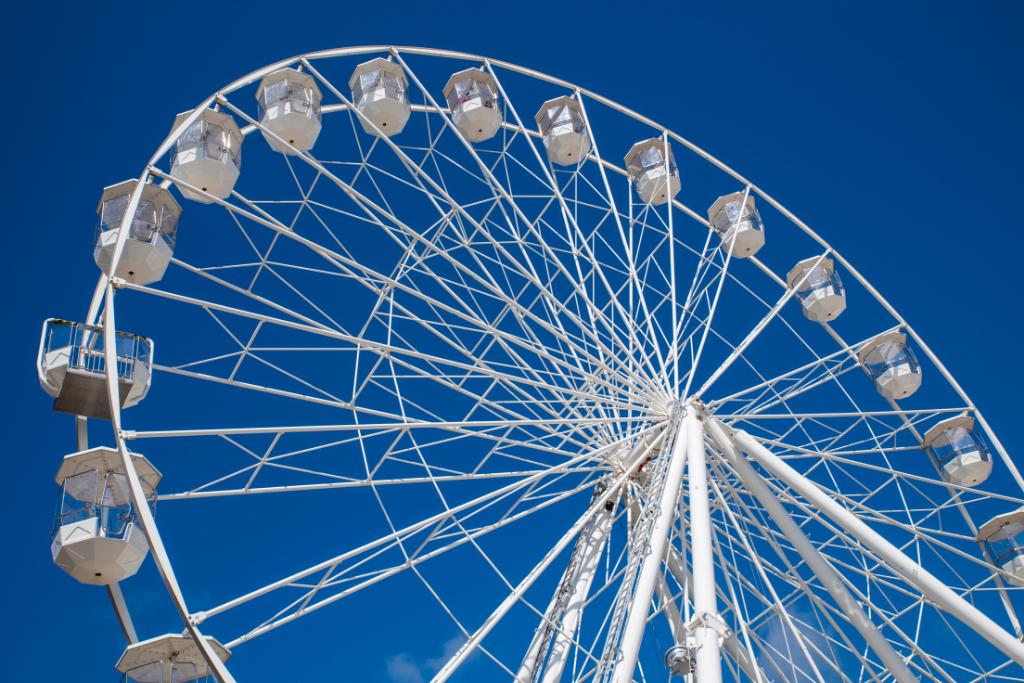 White ferris wheel against blue sky