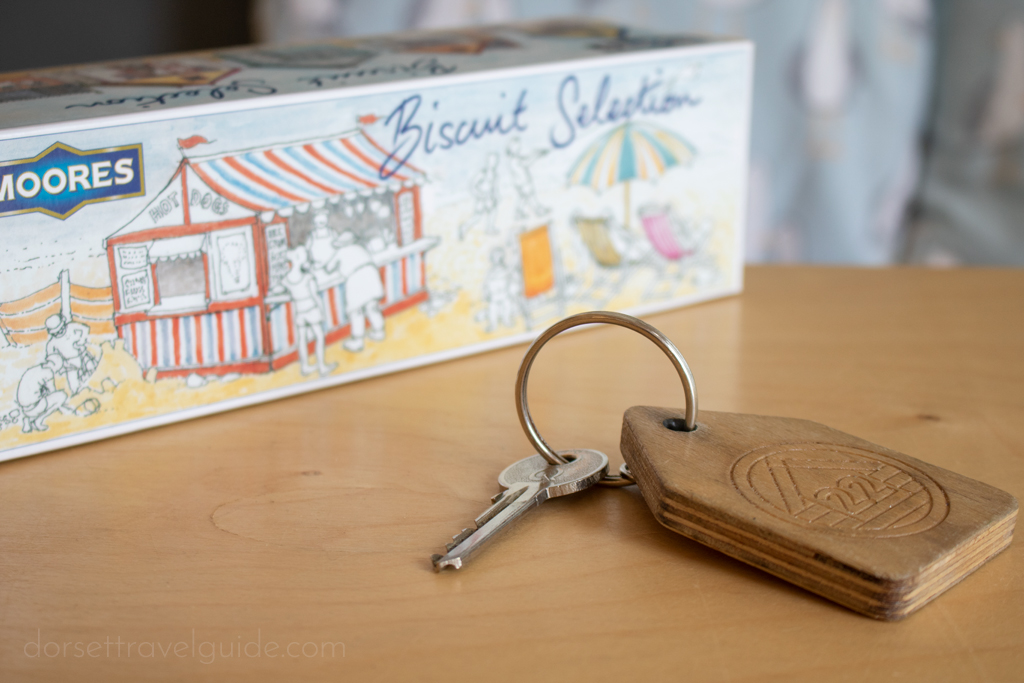 Key with wooden keyring on a table