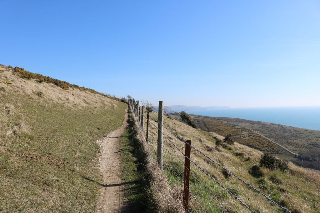 Walking along the back of Lulworth Cove Dorset