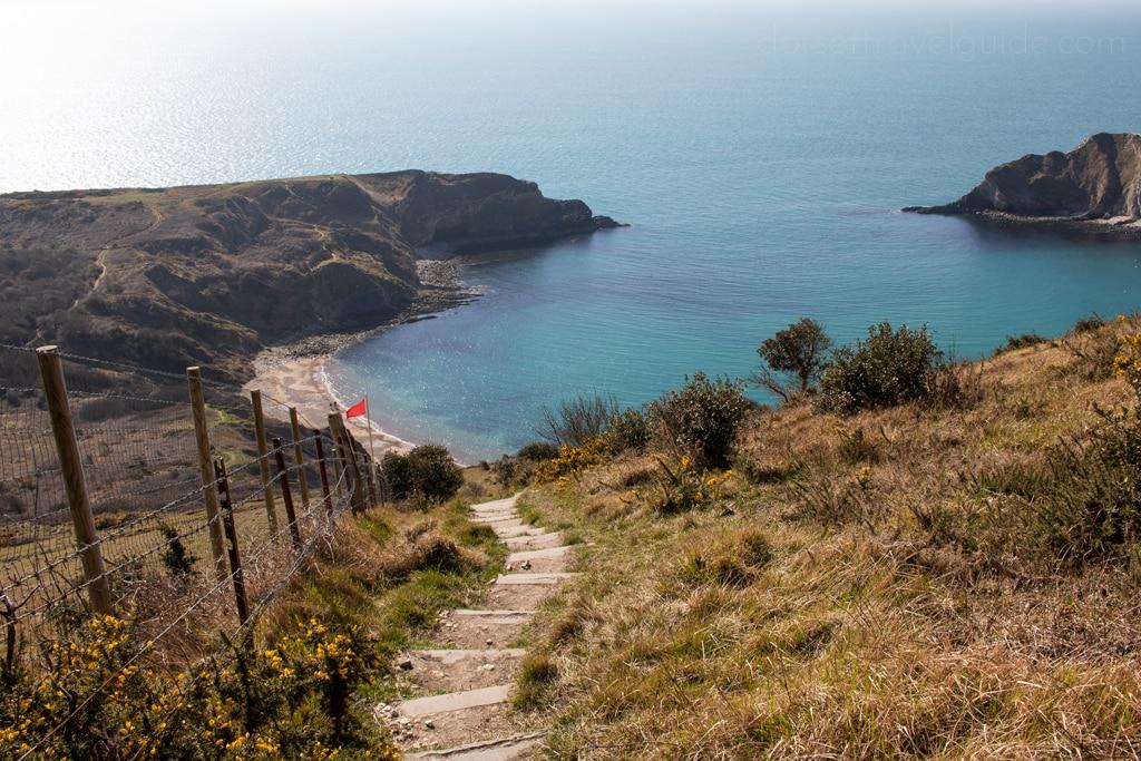 Steps leading down to Lulworth Cove on a coast path walk