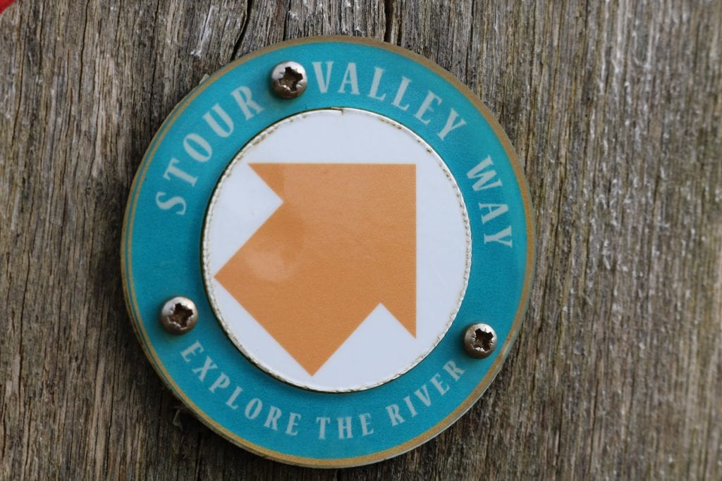 Stour Valley Way circular marker with orange arrows