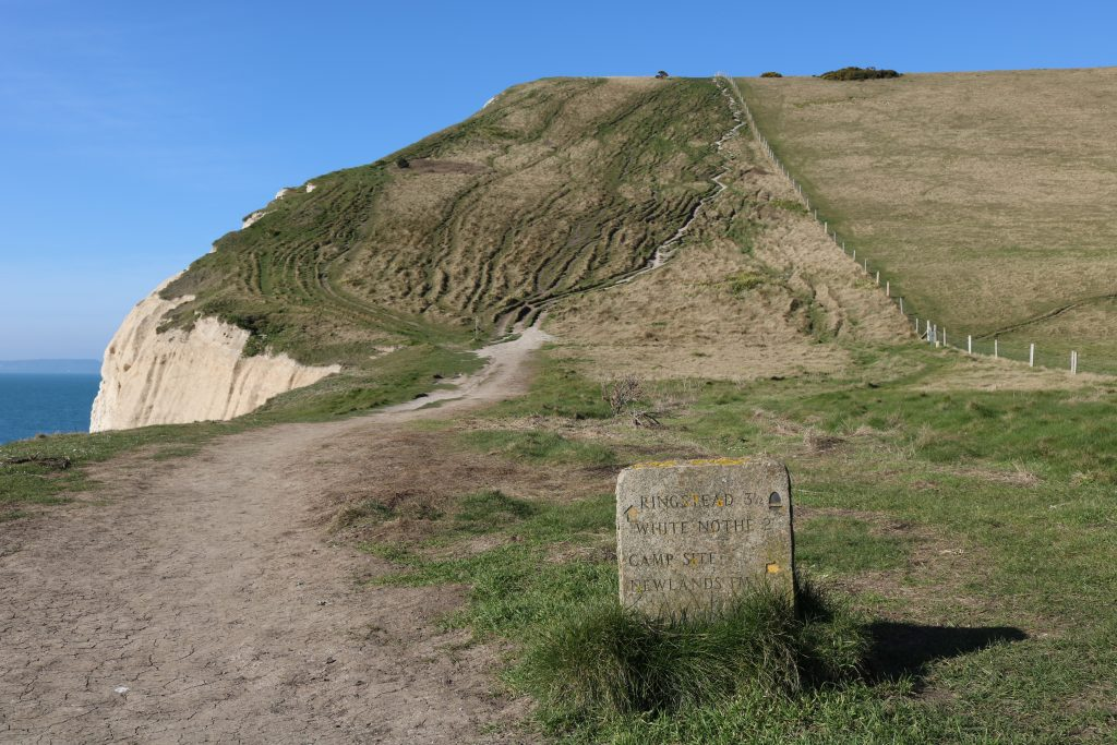 Stone signpost in front of Swyre Head in Dorset