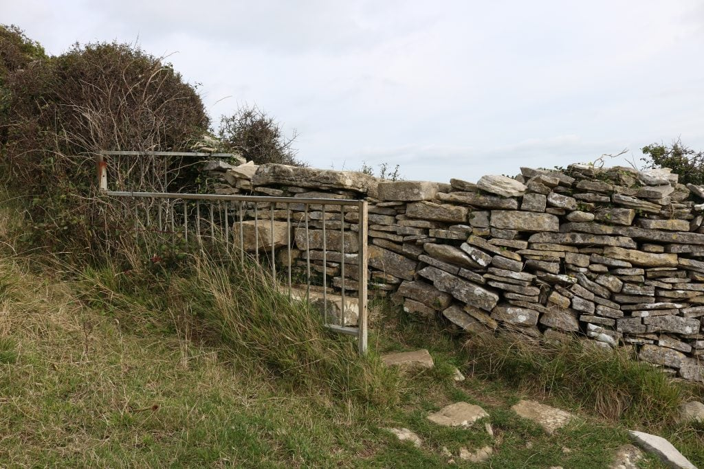 Stone wall and stile on Dancing Ledge walk back to Durlston