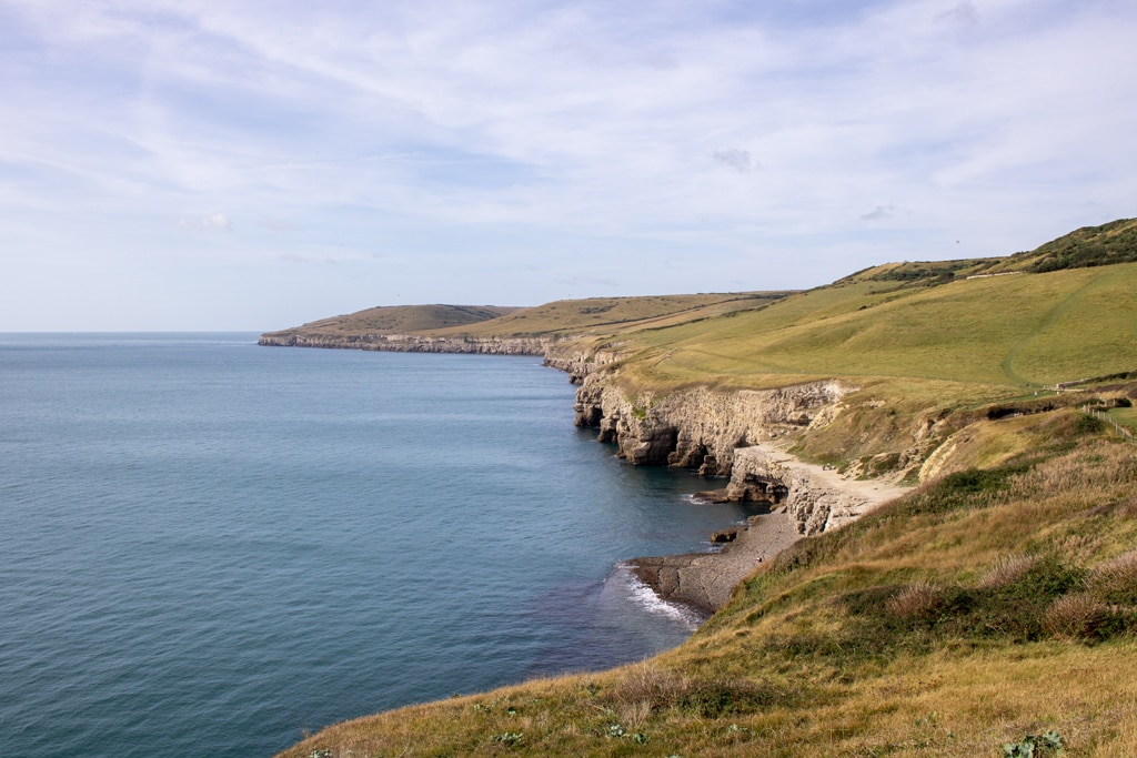 Dancing Ledge viewed from the walk on South West Coast Path
