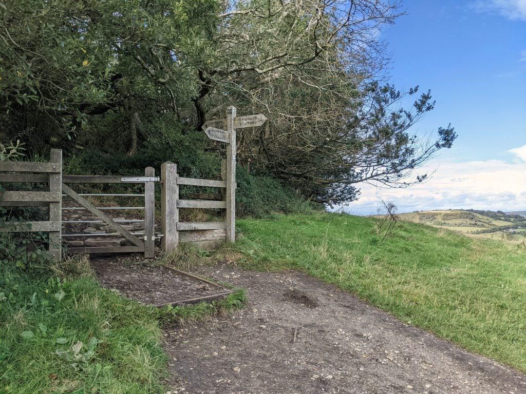 Gate and wooden signpost on Golden Cap walk